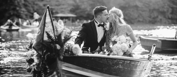 New York Central Park Elopement Wedding. Couple kissing on the boat