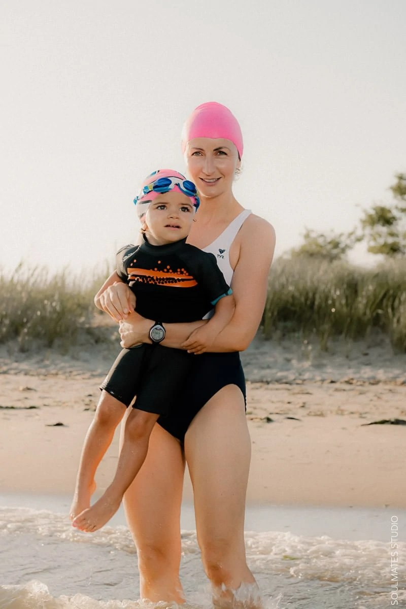 New York Family fun beach photo. Mum and small child in the water