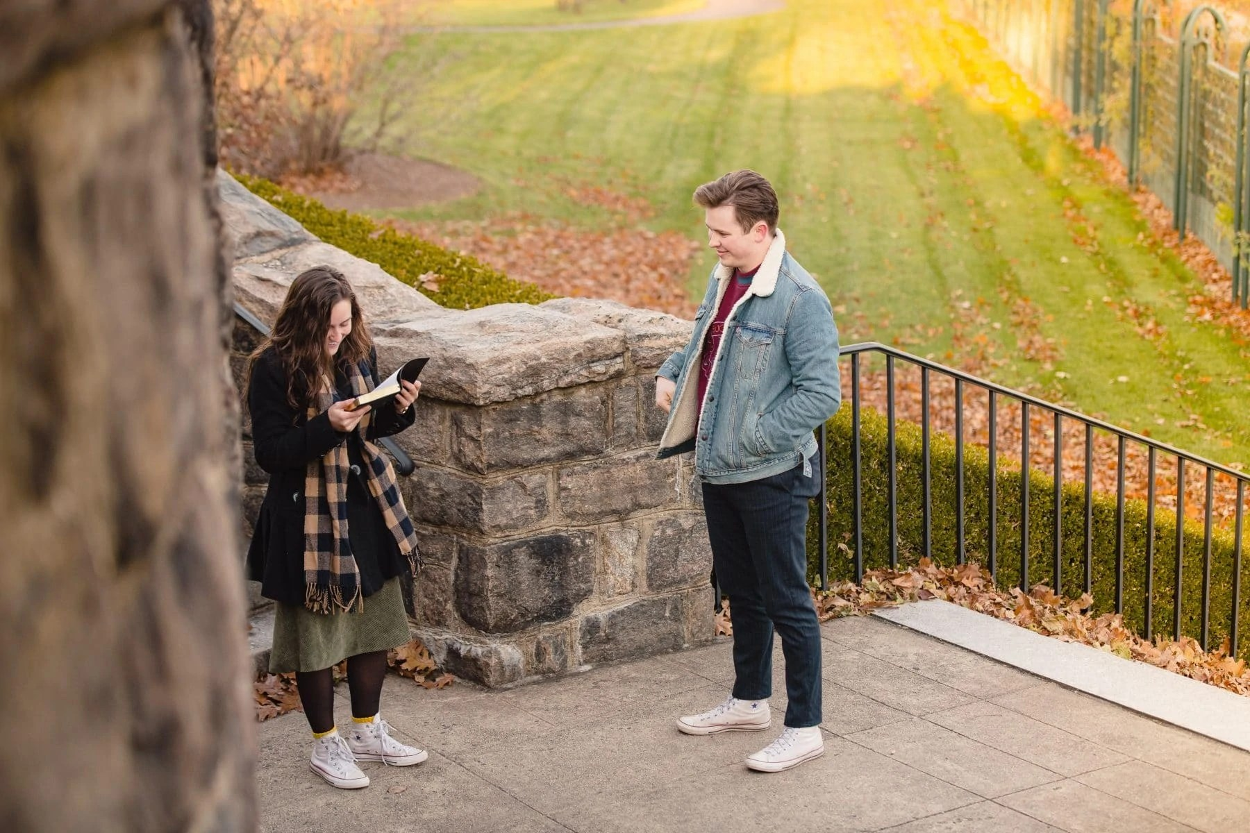 Surprised girl is opening the book and reading the letter from her boyfriend at the New York Botanical Garden