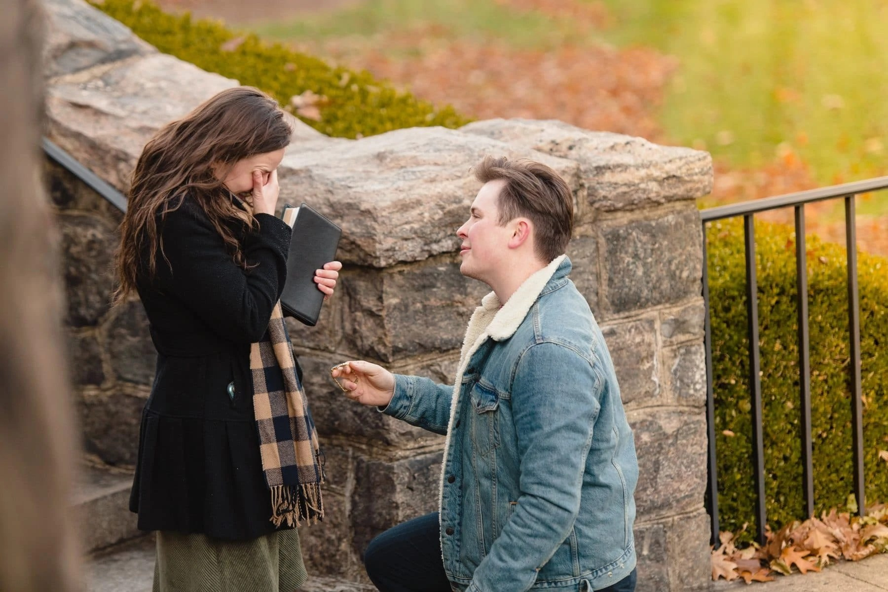 The girlfriend is crying when the boyfriend is on his knee proposing during New York Botanical Garden Surprise Proposal
