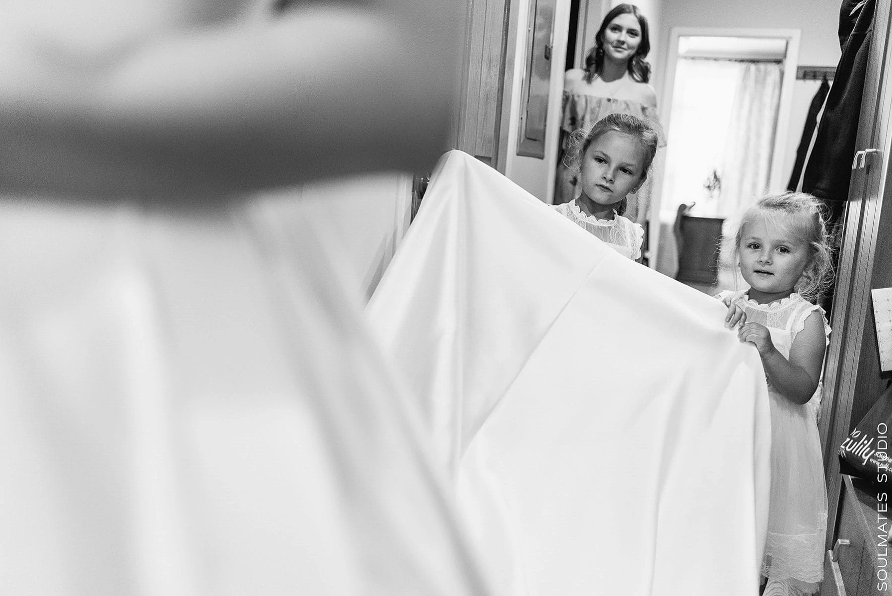 Brooklyn Flower Girls holding the wedding dress
