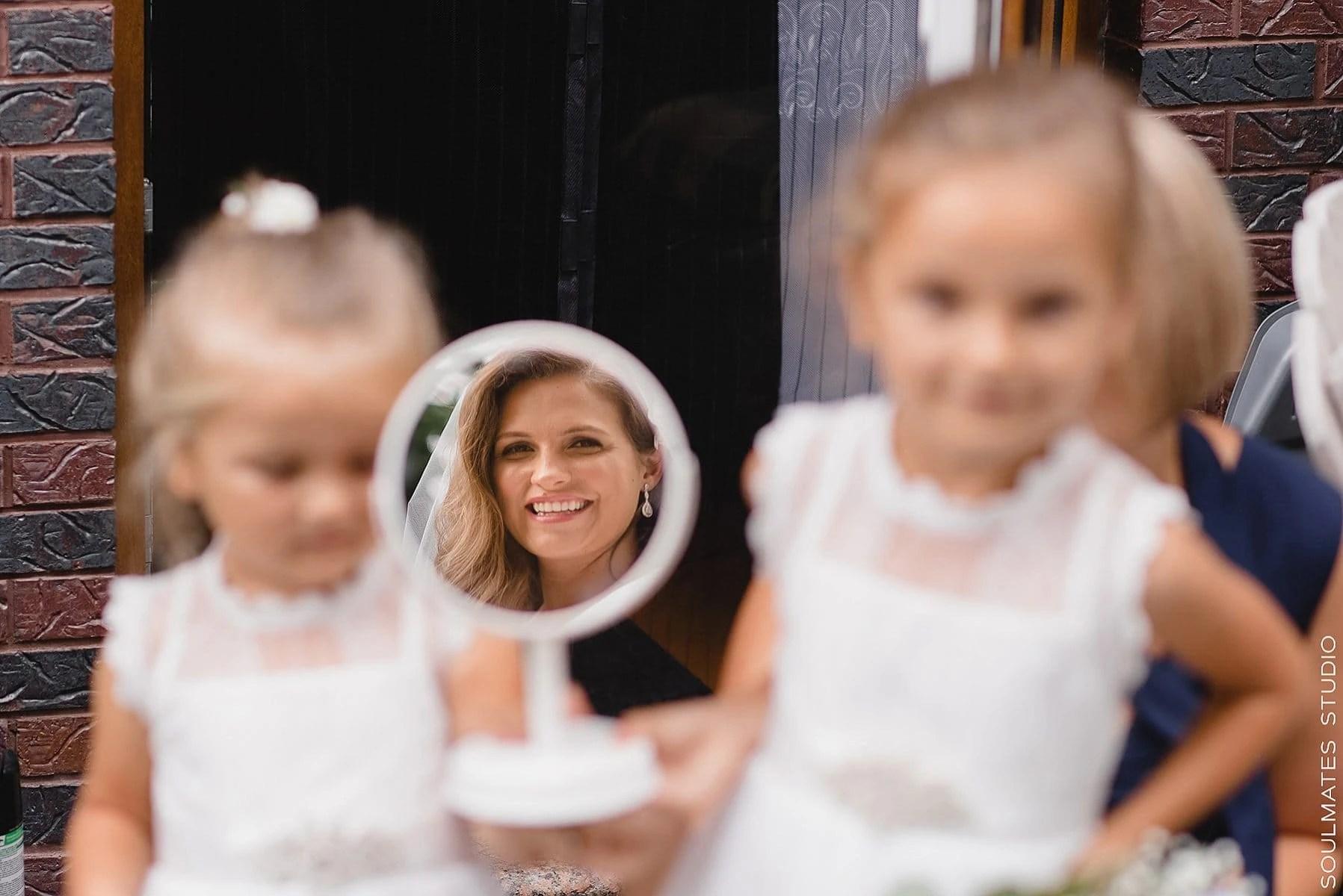 Brooklyn Bride Portrait reflecting in the mirror held by flower girls