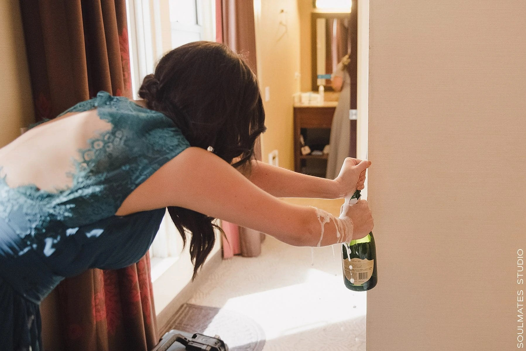 Manhattan City Wedding Champagne buzzing out of the buttle while opening