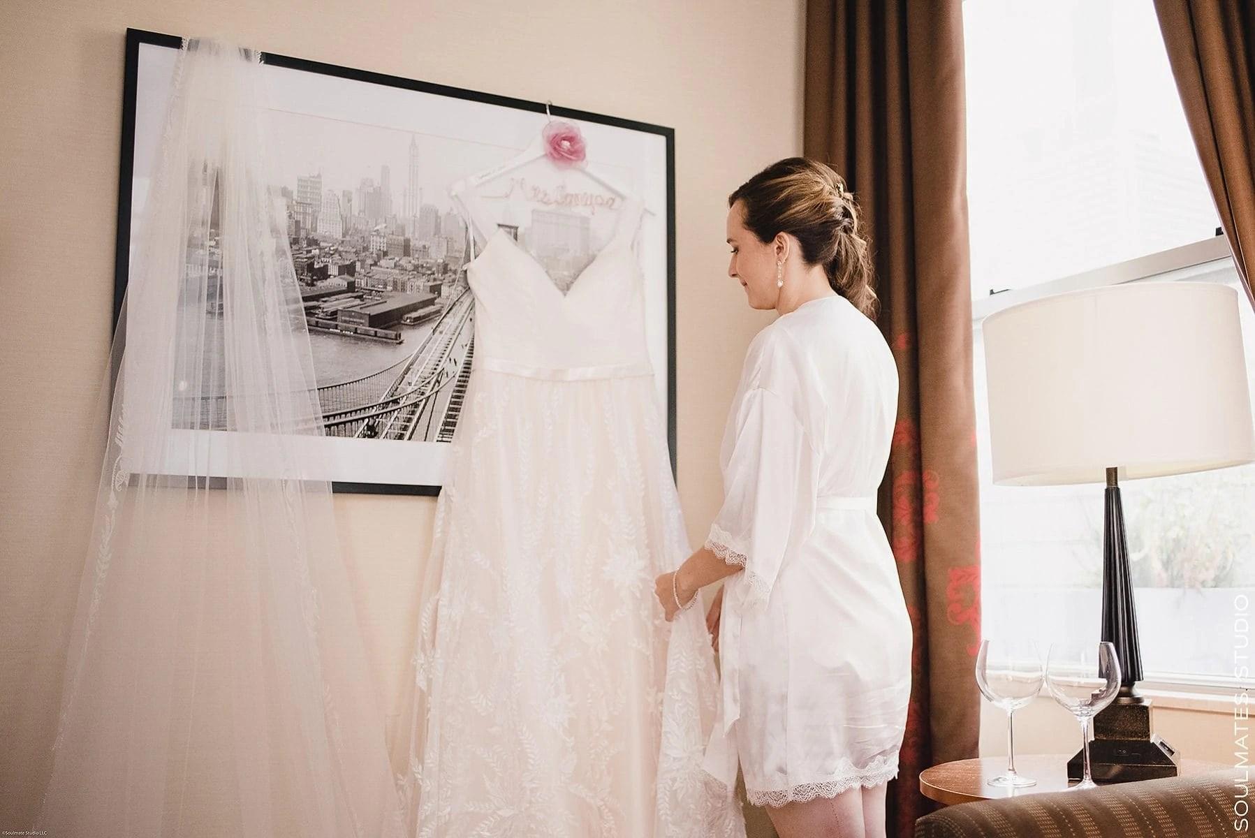 Bride is looking at her dress during Manhattan Wedding