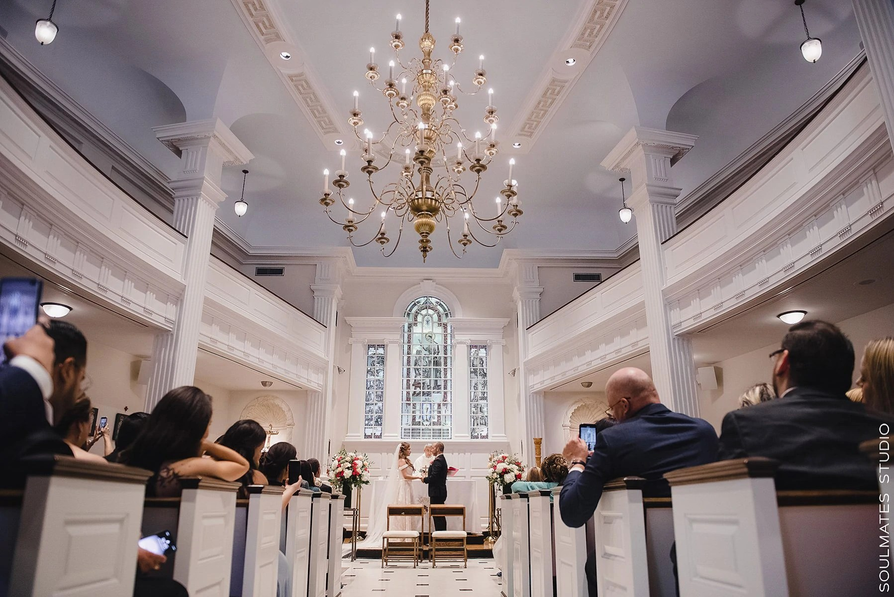Bride walking down the alis at Manhattan Our Lady of the Rosary Church