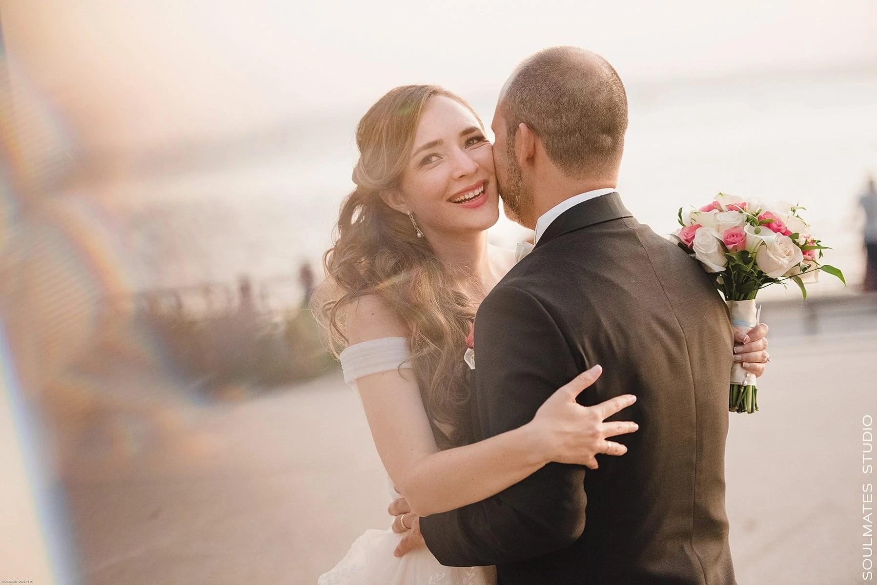 Bride hugging the Groom during wedding session at Battery Garden Park
