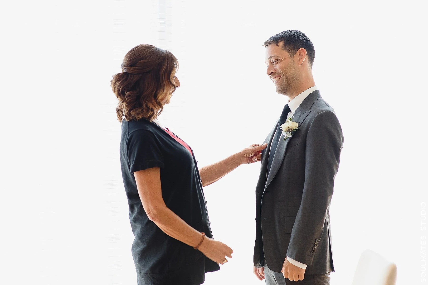 Mom helping the groom te get ready at New Jersey Hyatt Regency Jersey City Wedding