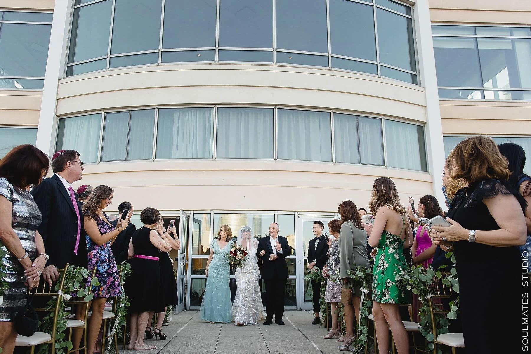Bride walking down the aisle at Hyatt Regency Jersey City Wedding
