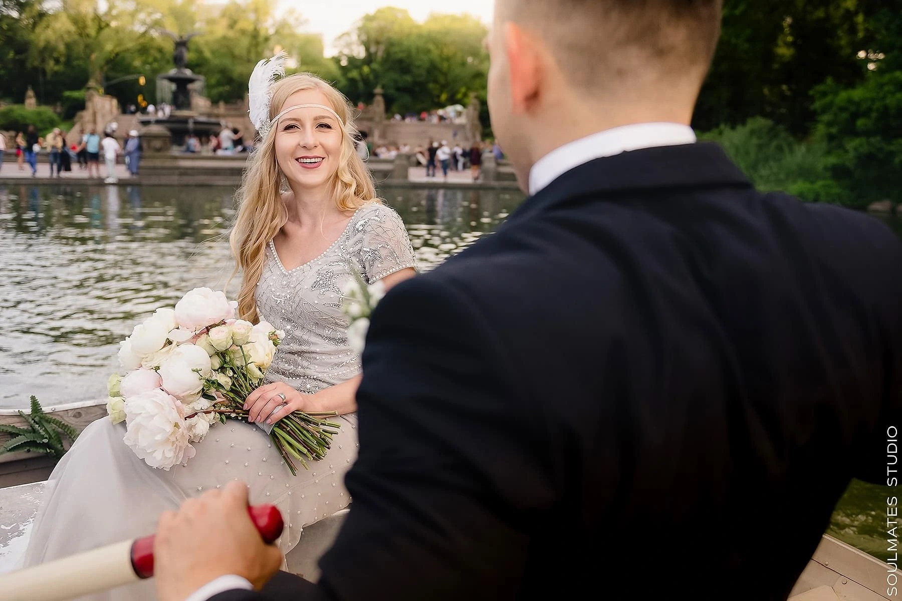 Bride and Groom on the boat on the Central Park Lake