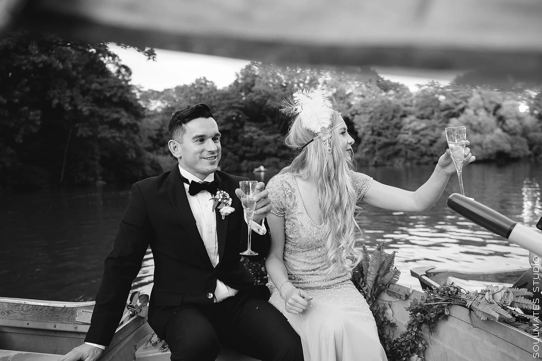 Bride and Groom toasting the glass of sparkling wine on the boat on the Central Park lake
