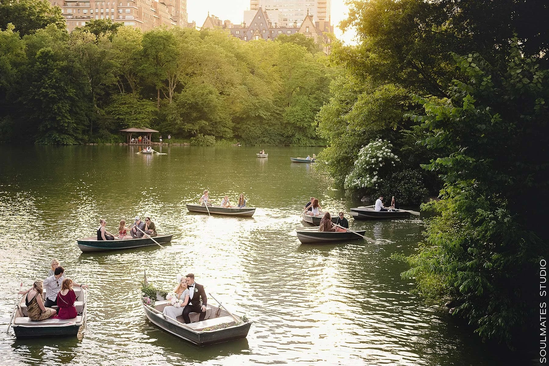 Bride and groom mingling on the boat on Central Park Lake
