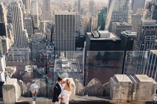 Engagement couple standing on the Top of the Rock Terrace