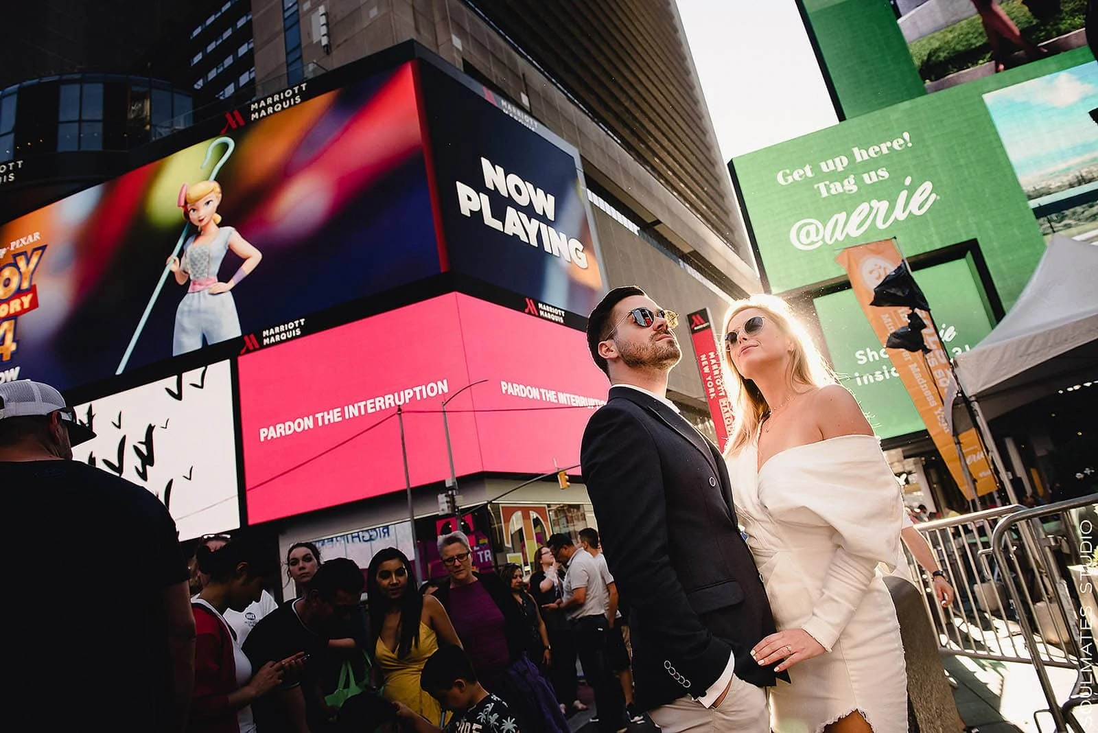 Engagement Couple standing at Times Square Center