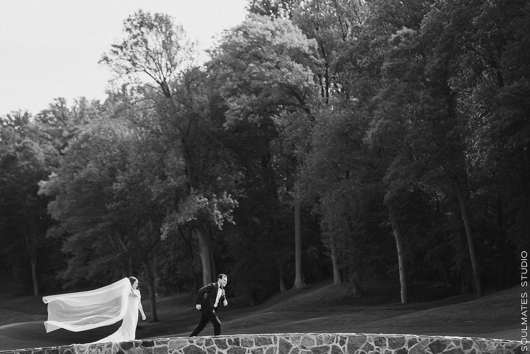 Groom running away from the Bride at Fresh Meadow Golf Course