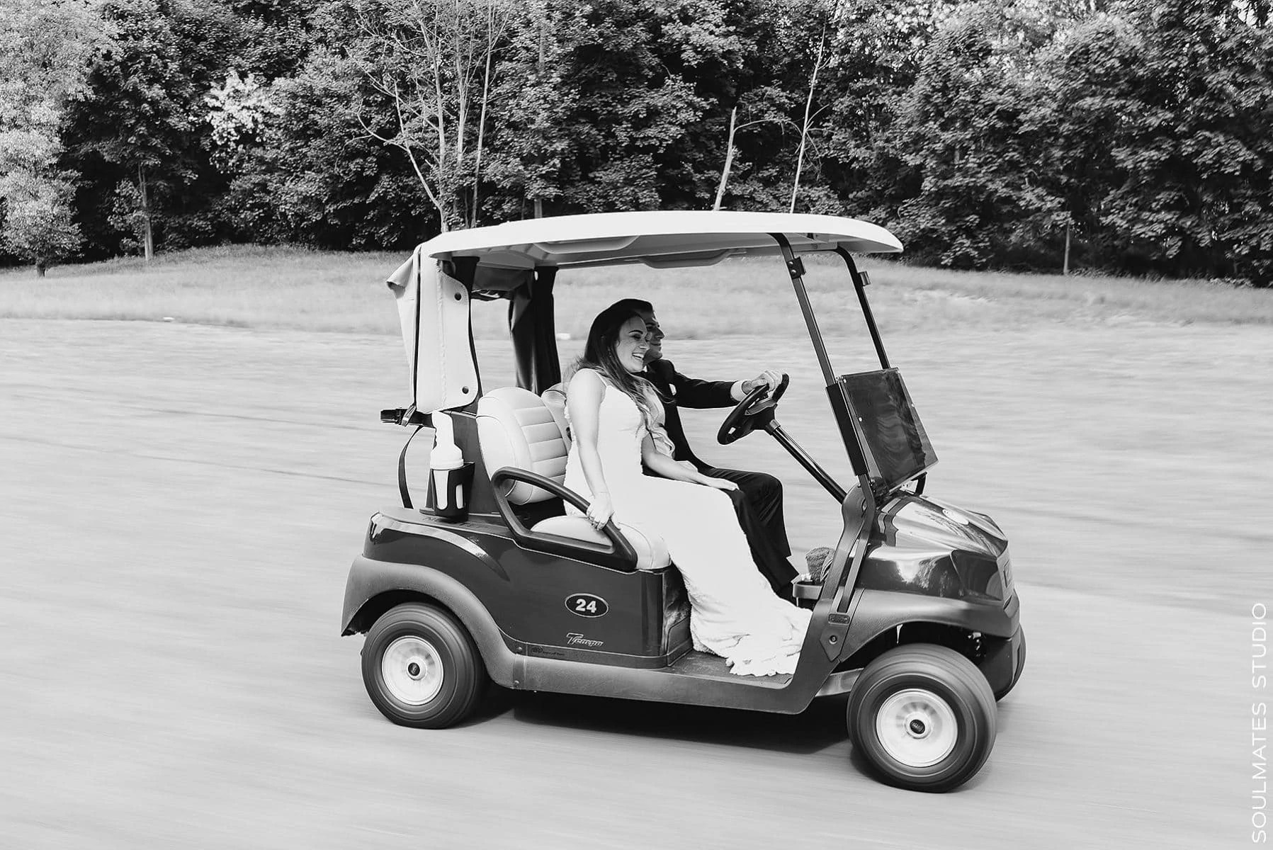 Bride and Groom riding the golf cart at Fresh Meadow Country Club