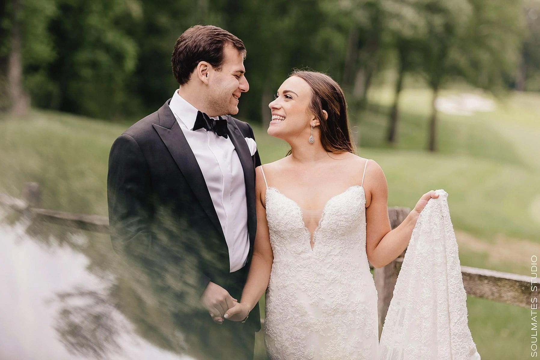 Bride and groom laughing before Fresh Meadow Country Club Wedding