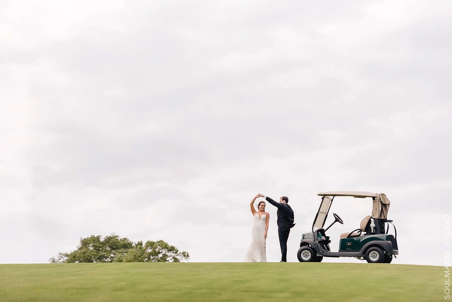 Bride and groom dancing on the golf course at Fresh Meadow Country Club