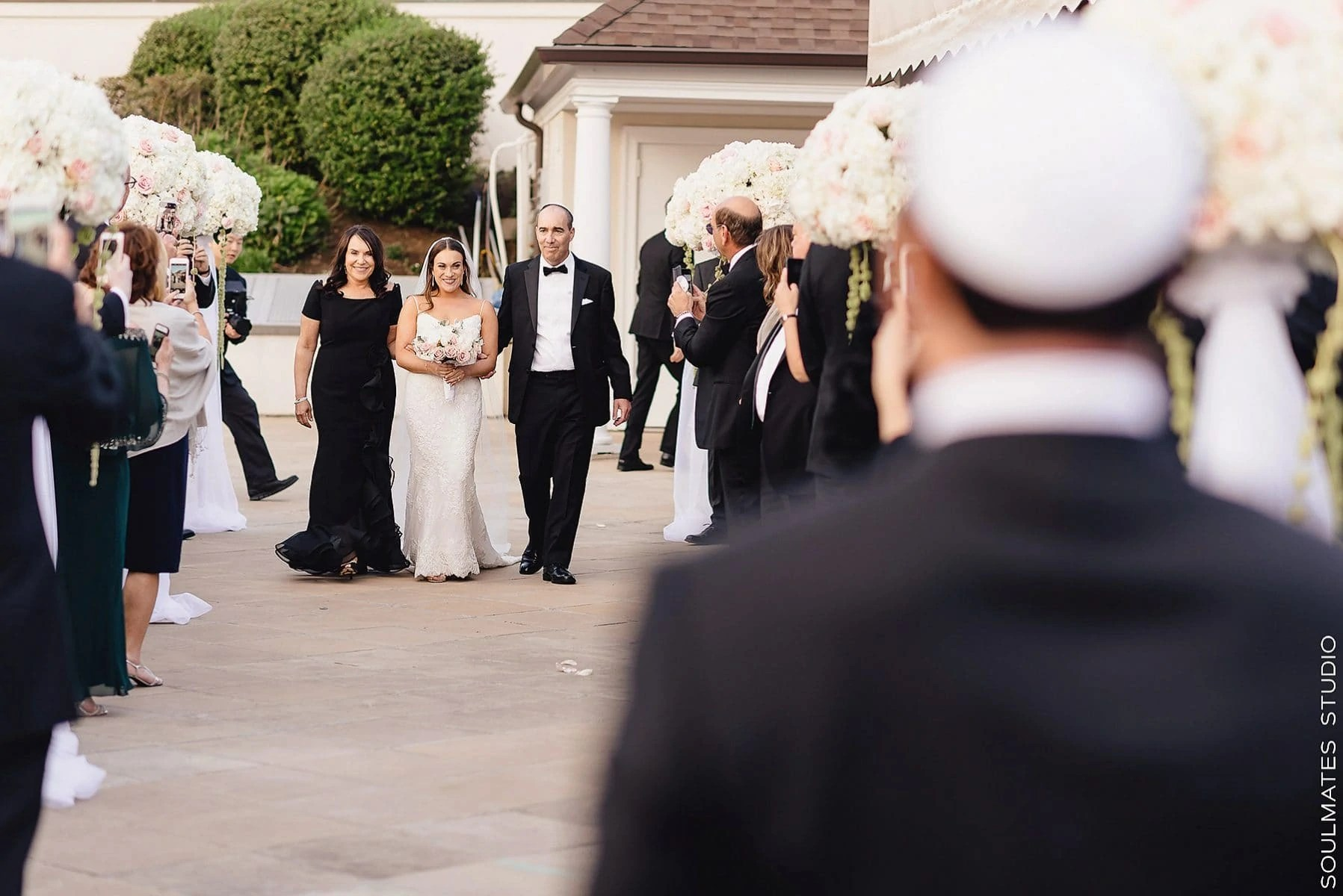 Bride walking down the alis at the Fresh Meadow Country Club Jewish Wedding