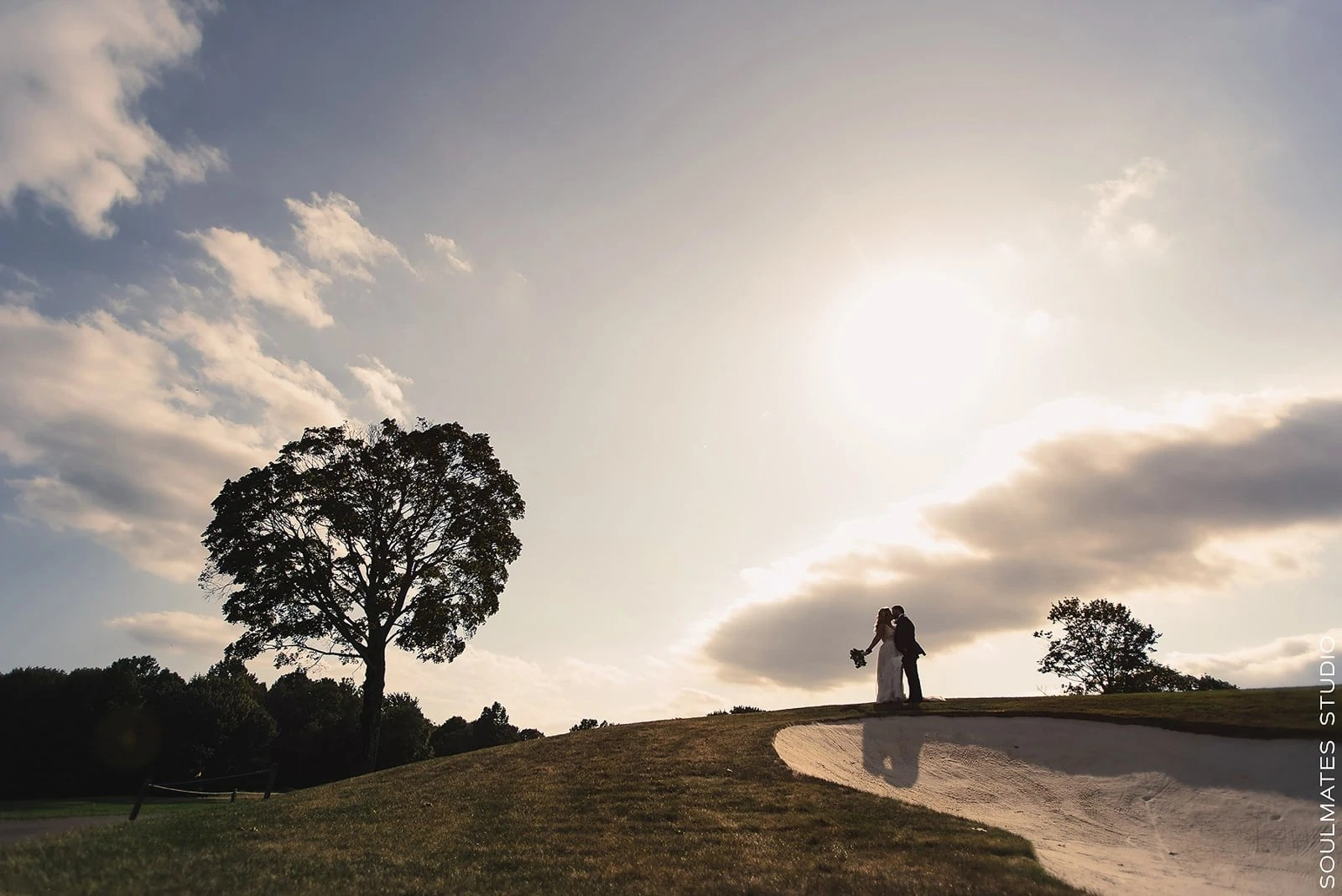 Sunset wedding portrait at the Paramount Country Club Golf Course