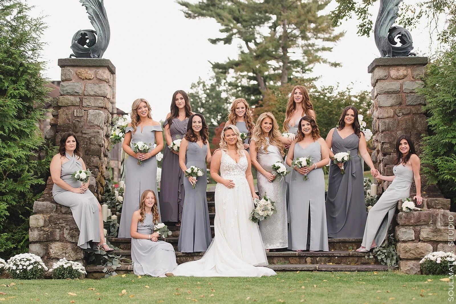 Bridesmaids group styled on the steps of Paramount Country Club