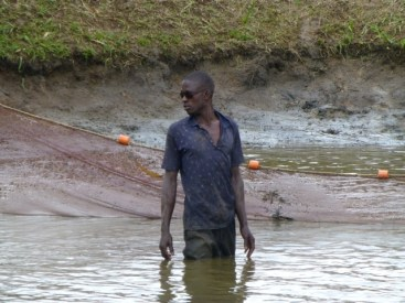Isimah, Secretary and too cool for school, even thigh deep in muddy waters