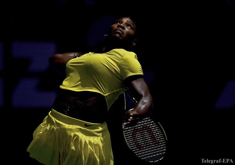 epa05126121 Serena Williams of the US serves against Maria Sharapova of Russia during their quarter finals round on day nine of the Australian Open tennis tournament in Melbourne, Australia, 26 January 2016.  EPA/LUKAS COCH AUSTRALIA AND NEW ZEALAND OUT