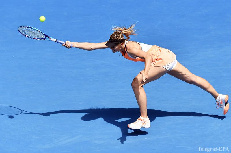 epa05126132 Maria Sharapova of Russia in action against Serena Williams of the US during their quarter finals round on day nine of the Australian Open tennis tournament in Melbourne, Australia, 26 January 2016.  EPA/TRACEY NEARMY AUSTRALIA AND NEW ZEALAND OUT