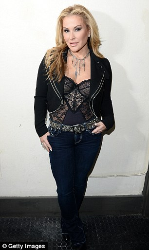 35C9156700000578-3665991-Healing_In_2014_the_pop_star_pictured_in_March_of_2016_underwent-a-13_1467212300484