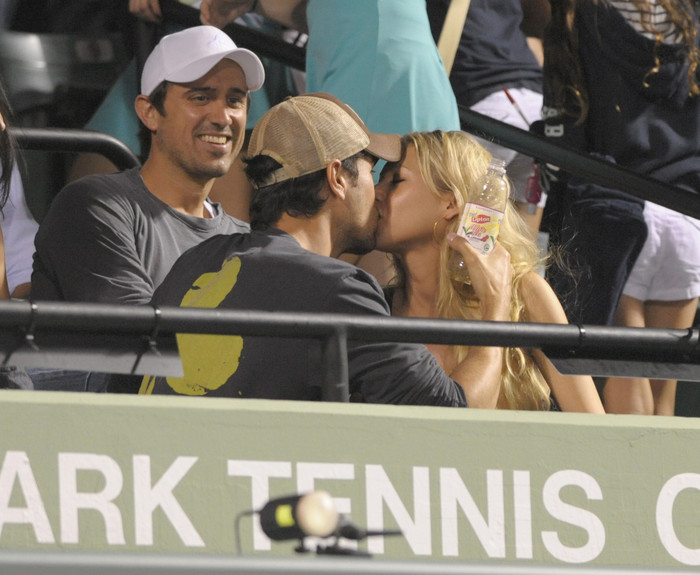 Enrique Iglesias and his girlfriend Anna Kournikova look very much in love at the Sony Ericsson Open Day 11