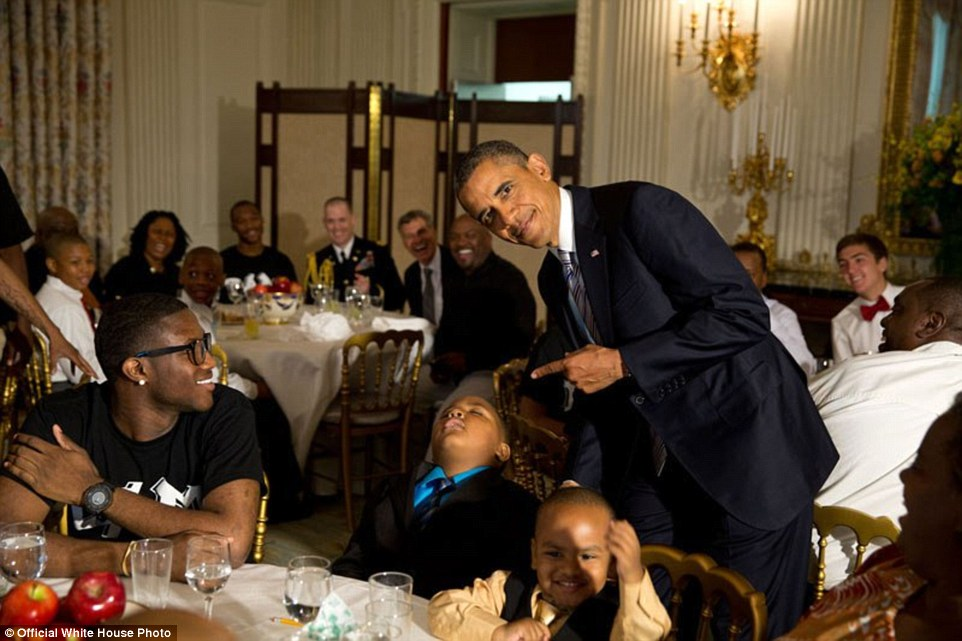 3a3f91b400000578-3926100-june_14_2013_obama_with_a_young_boy_who_had_fallen_asleep_during-a-11_1478871703565