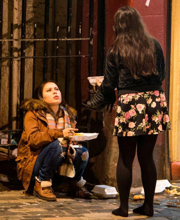 revelers-descend-on-edinburghs-city-centre-to-bring-in-the-new-year-in-edinburgh-scotland-5