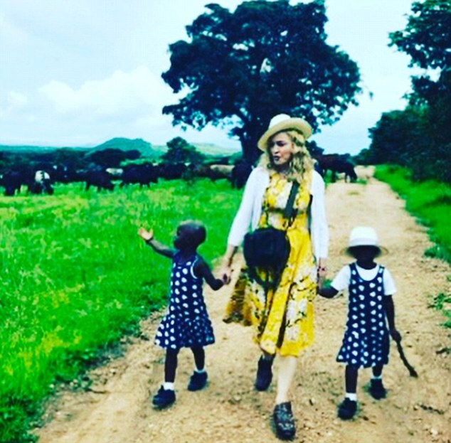 3CF8BCEA00000578-4203184-Madonna_shared_a_picture_on_Instagram_of_her_walking_hand_in_han-m-16_1486580149316