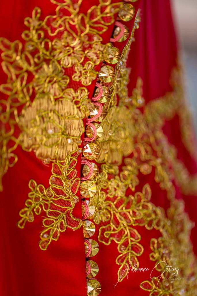 chinese dress detail gold embroidery on red dress buttons