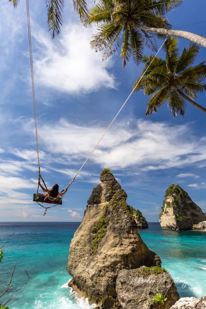 Content marketing, social media marketing, social media platforms, Instagram social media spot with a swing over Diamond Beach, Nusa Penida, Bali, Indonesia