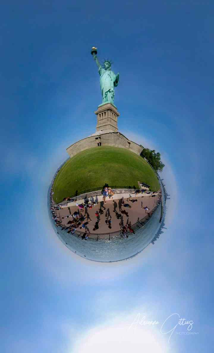 360 tiny planet of the statue of liberty, ellis island, new jersey, blue sky, green lady