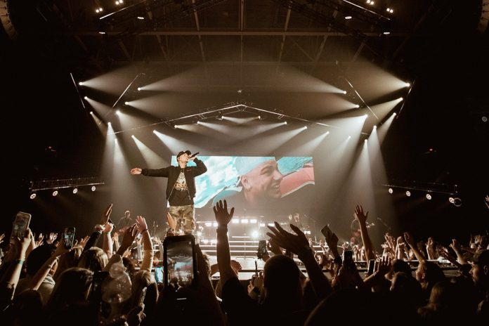 Kane Brown performing on his first headlining Live Forever Tour