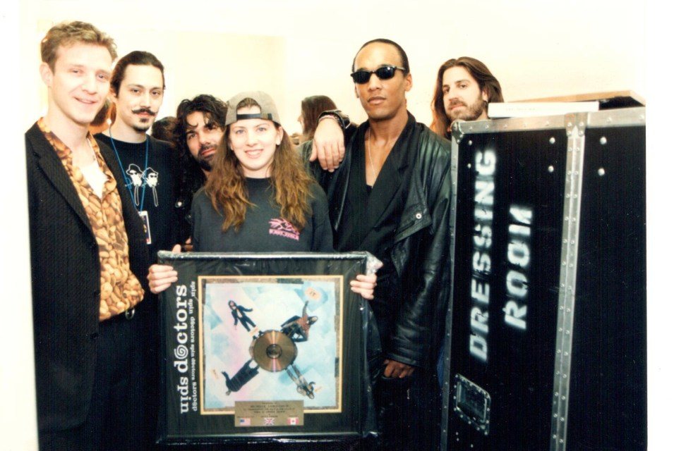 Michelle being presented a gold record from Spin Doctors circa 1994