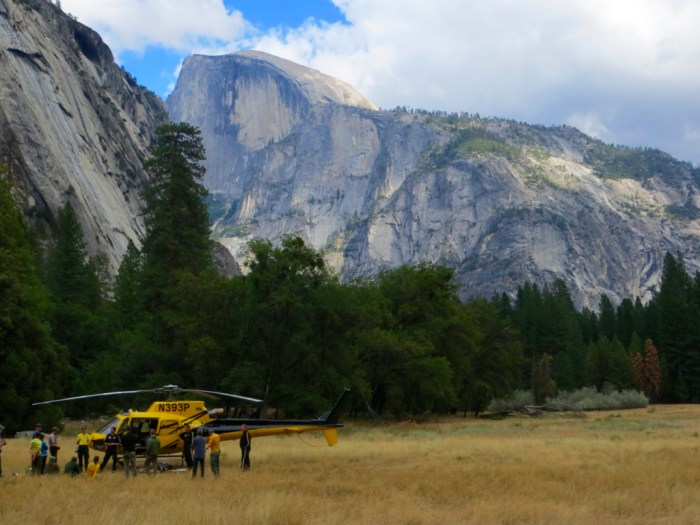 Rescue helicopter in front of Half Dome  in Yosemite Valley