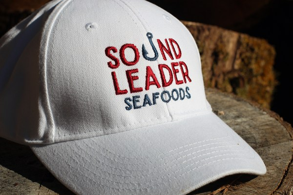closeup of cap with Sound Leader Seafoods in Bellingham, Washington