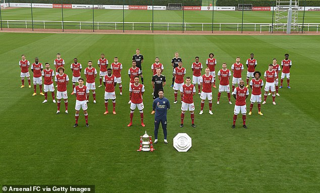 Arsenal released their 2020-21 team photo with Mesut Ozil (second-back, right) included