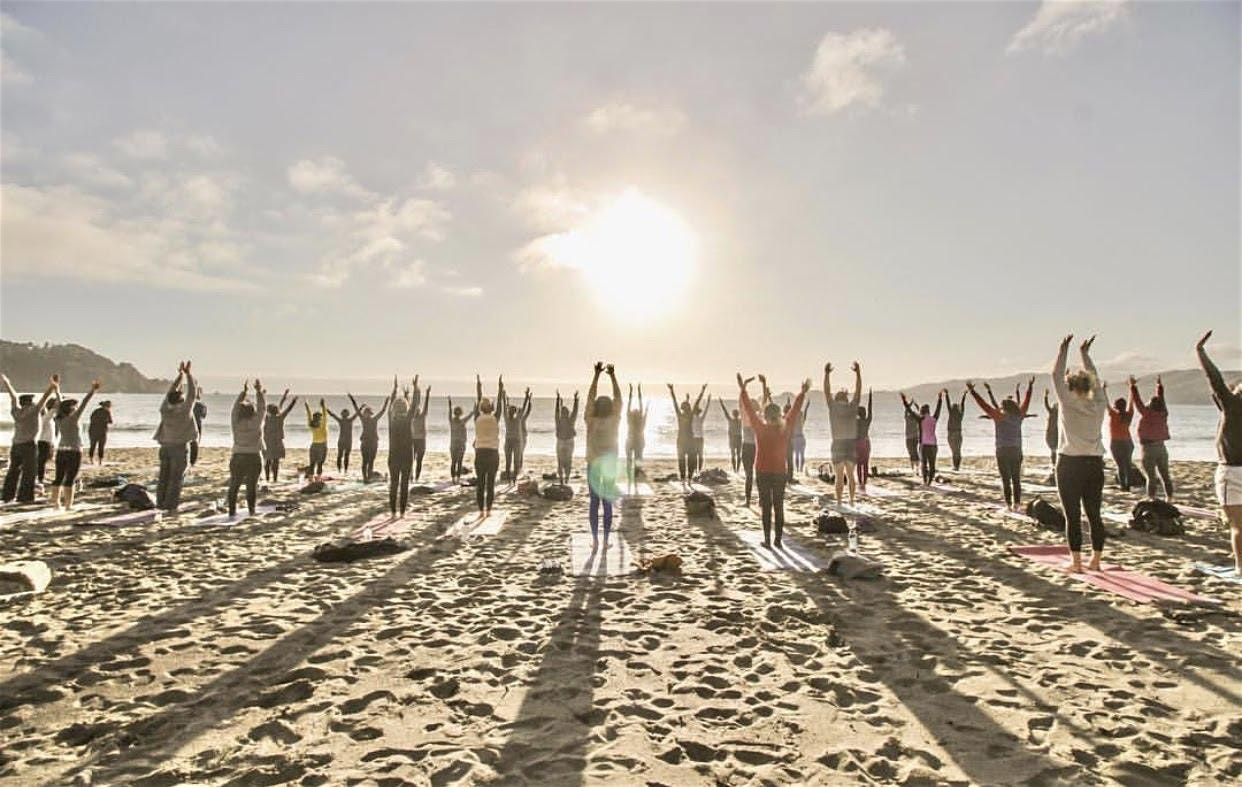 Join us on the beach for a powerful yoga flow, breathe to the rhythm of the Ocean's waves, groove to soulful beats, and bask in the magic of the sun setting over the pacific