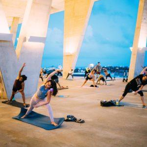 Socially distanced yogis practice outdoors