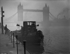 a-tugboat-docked-on-the-thames-near-tower-bridge-during-heavy-smog-in-december-1952