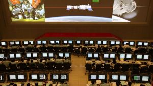 BEIJING, CHINA - JUNE 13: (CHINA OUT) Scientists look at the screen shows the Shenzhou X manned spacecraft conducting docking with the orbiting Tiangong-1 space module at Beijing Aerospace Control Center on June 13, 2013 in Beijing, China. China's Shenzhou X manned spacecraft successfully completed an automated docking with the orbiting Tiangong-1 space module on Thursday. (Photo by VCG/VCG via Getty Images)