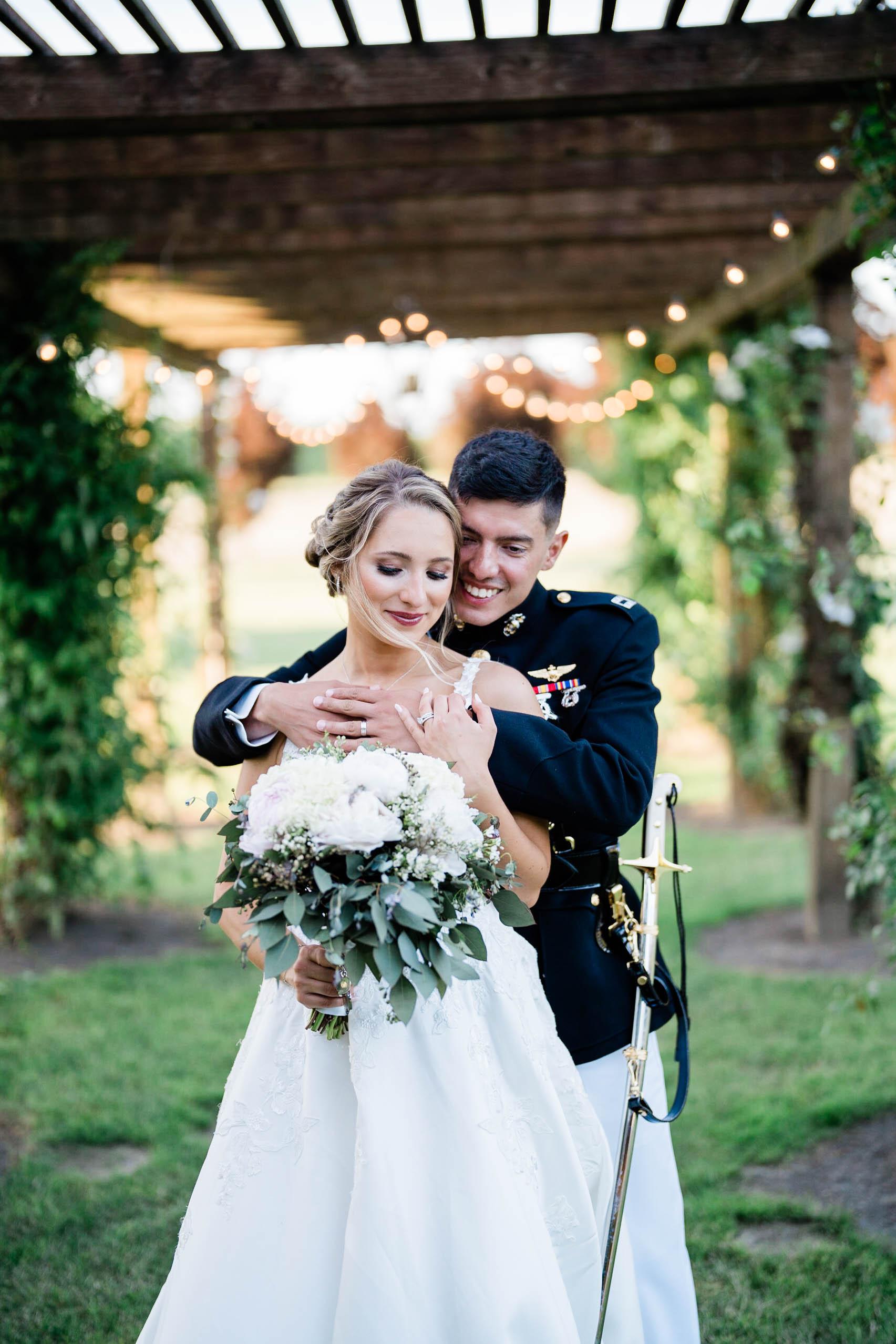 bride and groom pose outside craven farm wedding venue for gorgeous photos
