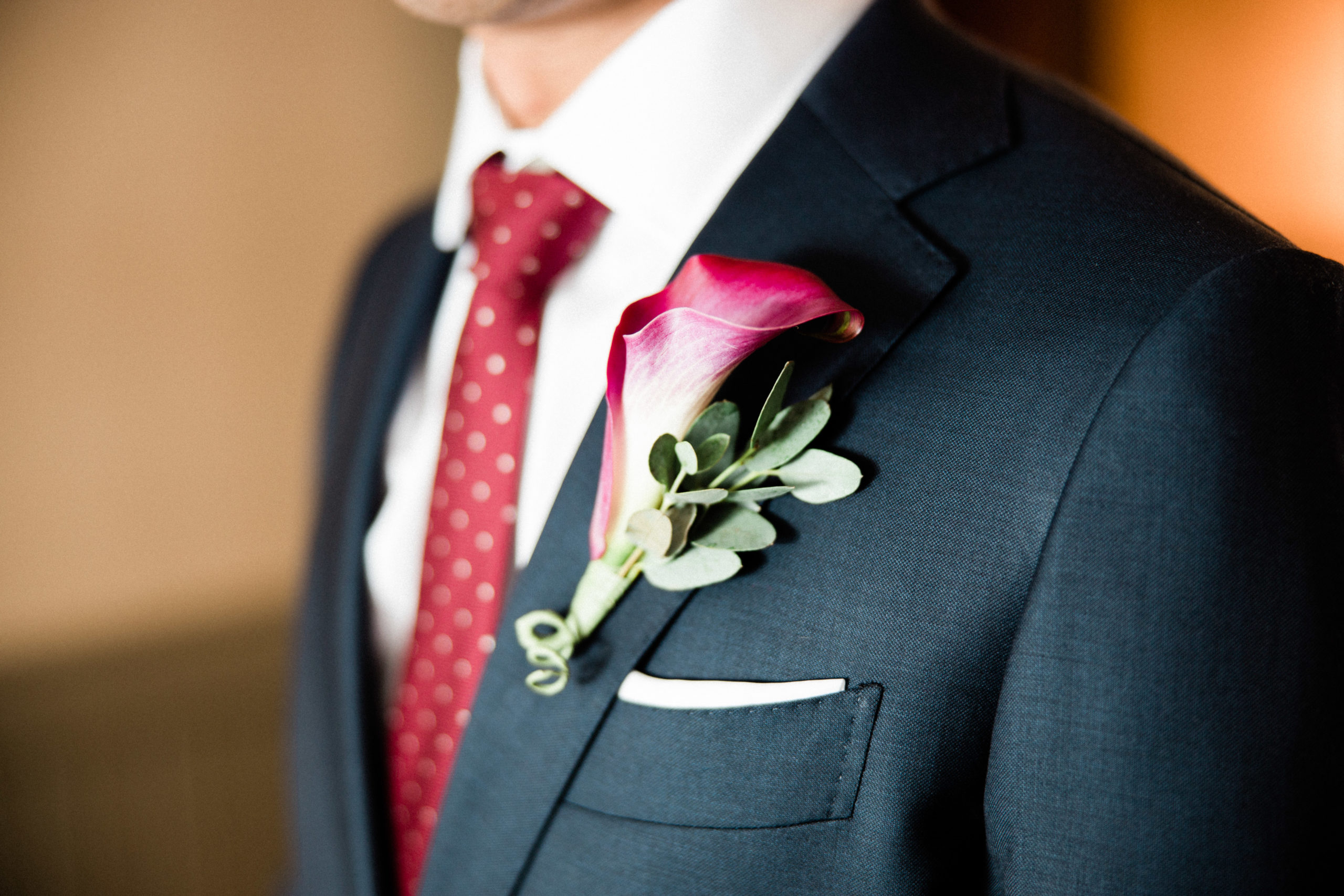 boutonniere on tuxedo on ceremony location in edgewater hotel in downtown seattle