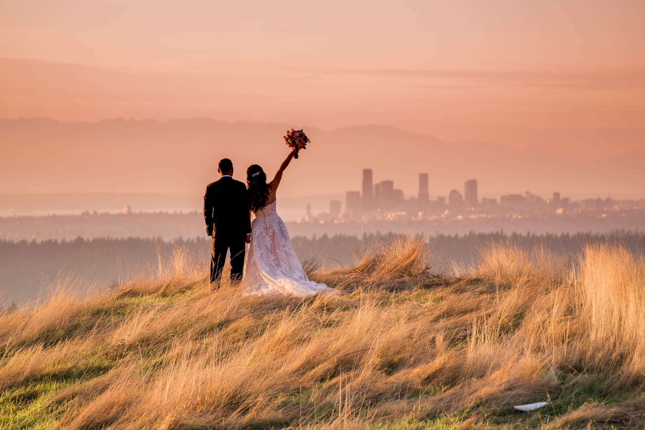bride and groom with seattle skyline at golf club wedding venue