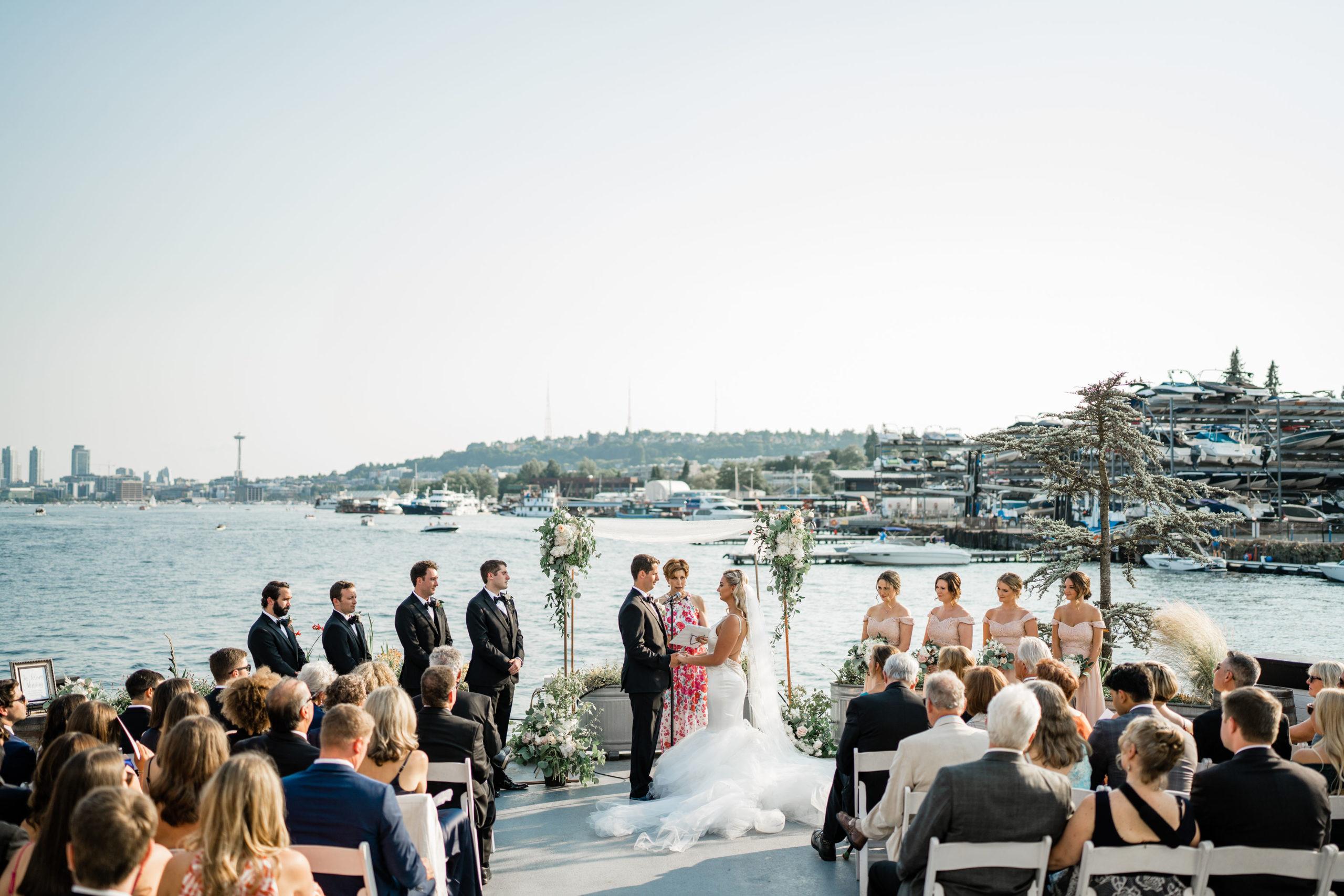guests watch bride and groom get married