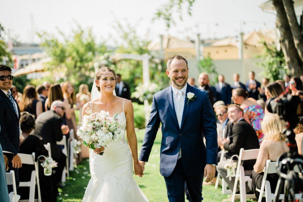 husband and wife walk down aisle at San Juan island destination wedding