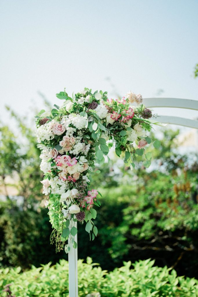 flowers decorate the ceremony arch at Roche Harbor Resort wedding